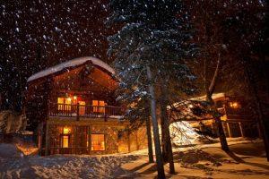 aqua log cabin outside night